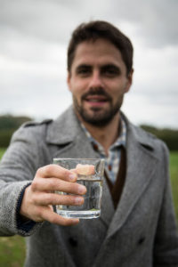 Emmerson Critchley toasts water.
